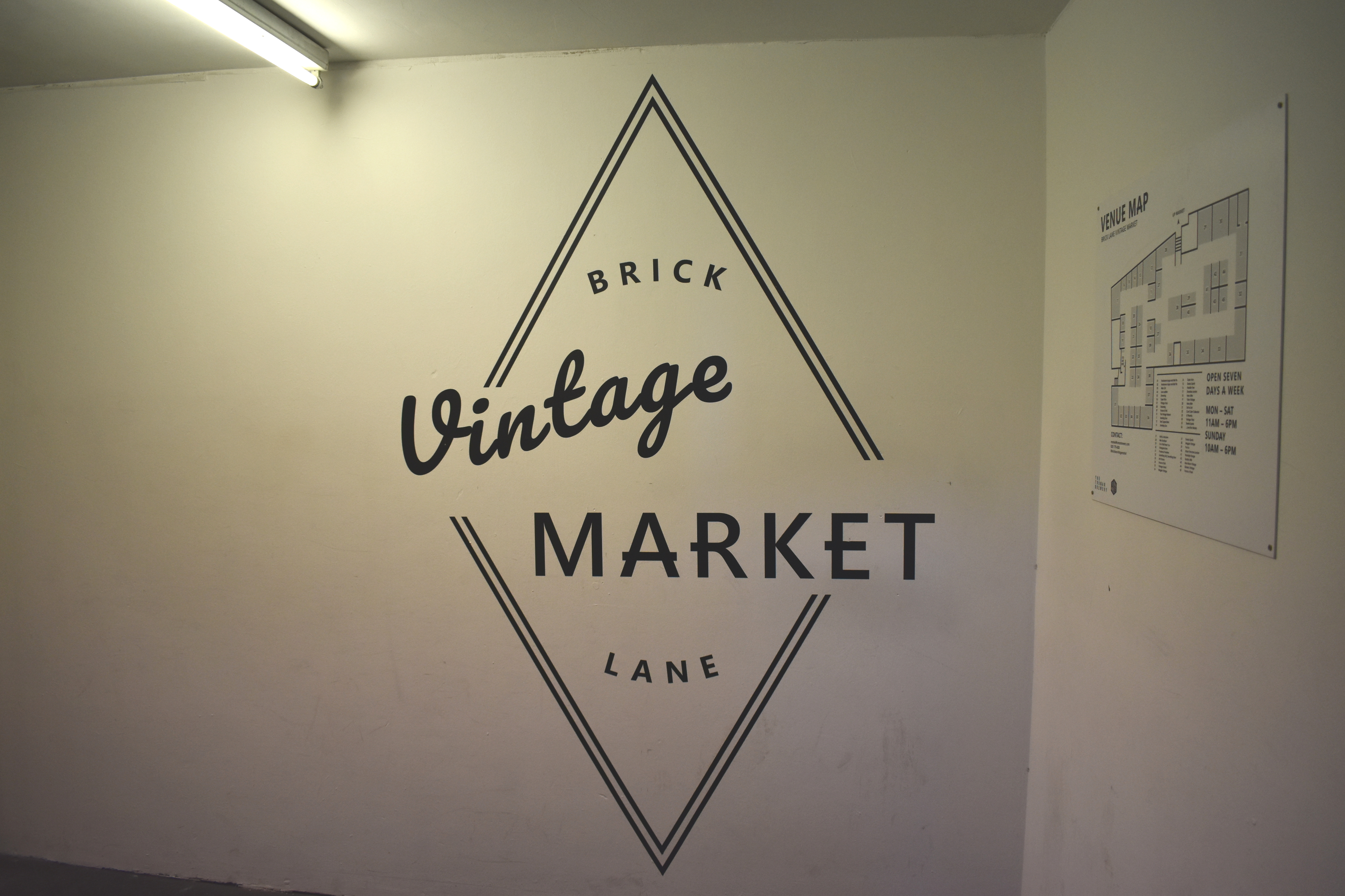 sign in building for vintage market