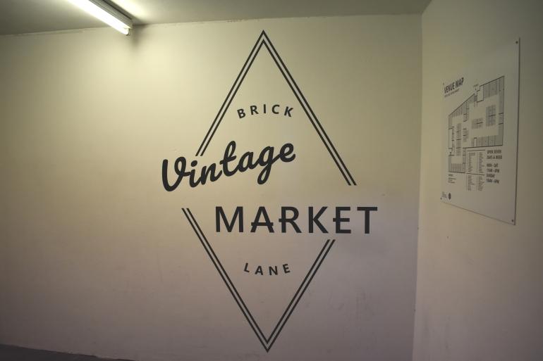 sign in building for vintage market