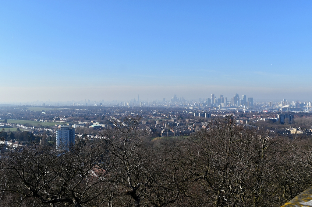 looking out to central london skyscrapers from severndroog castle on sunny day