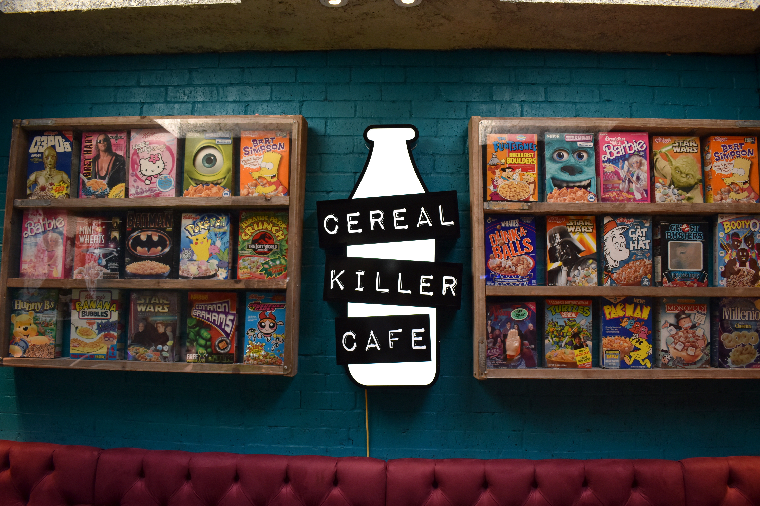 cafe sign in london with bright neon sign and cereal boxes surrounding