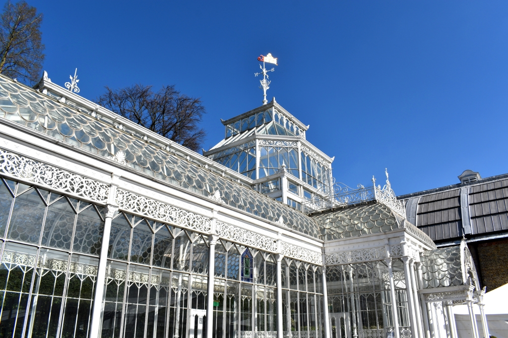 white iron conservatory at the Horniman Museum against blue sky