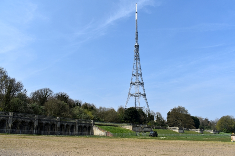 view of big tv tower in park on sunny day