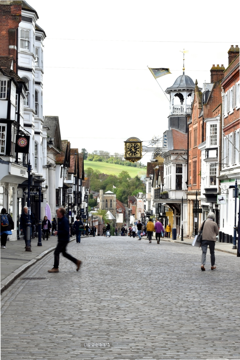 view of high street with people walking and shops