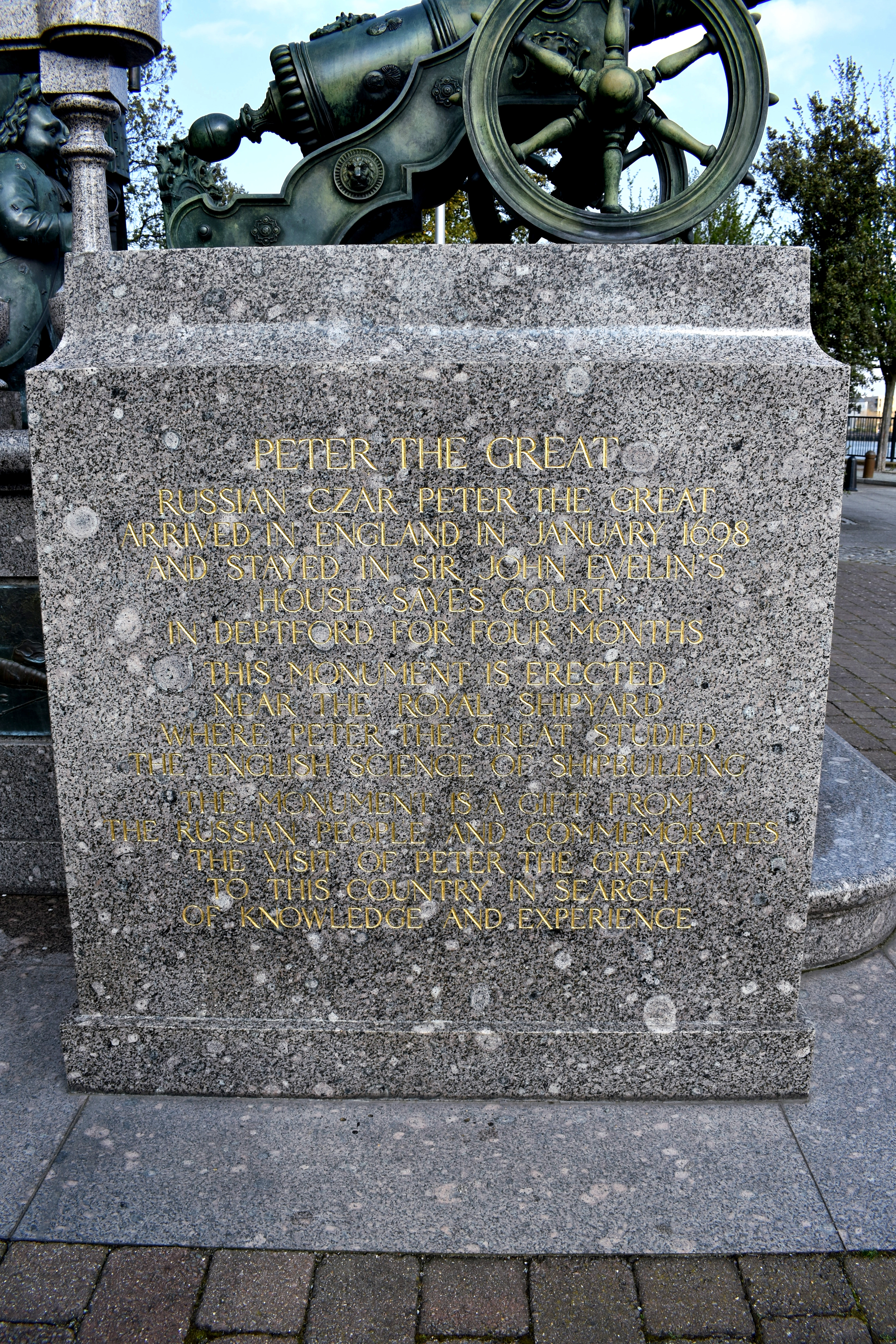 engraved writing on side of statue