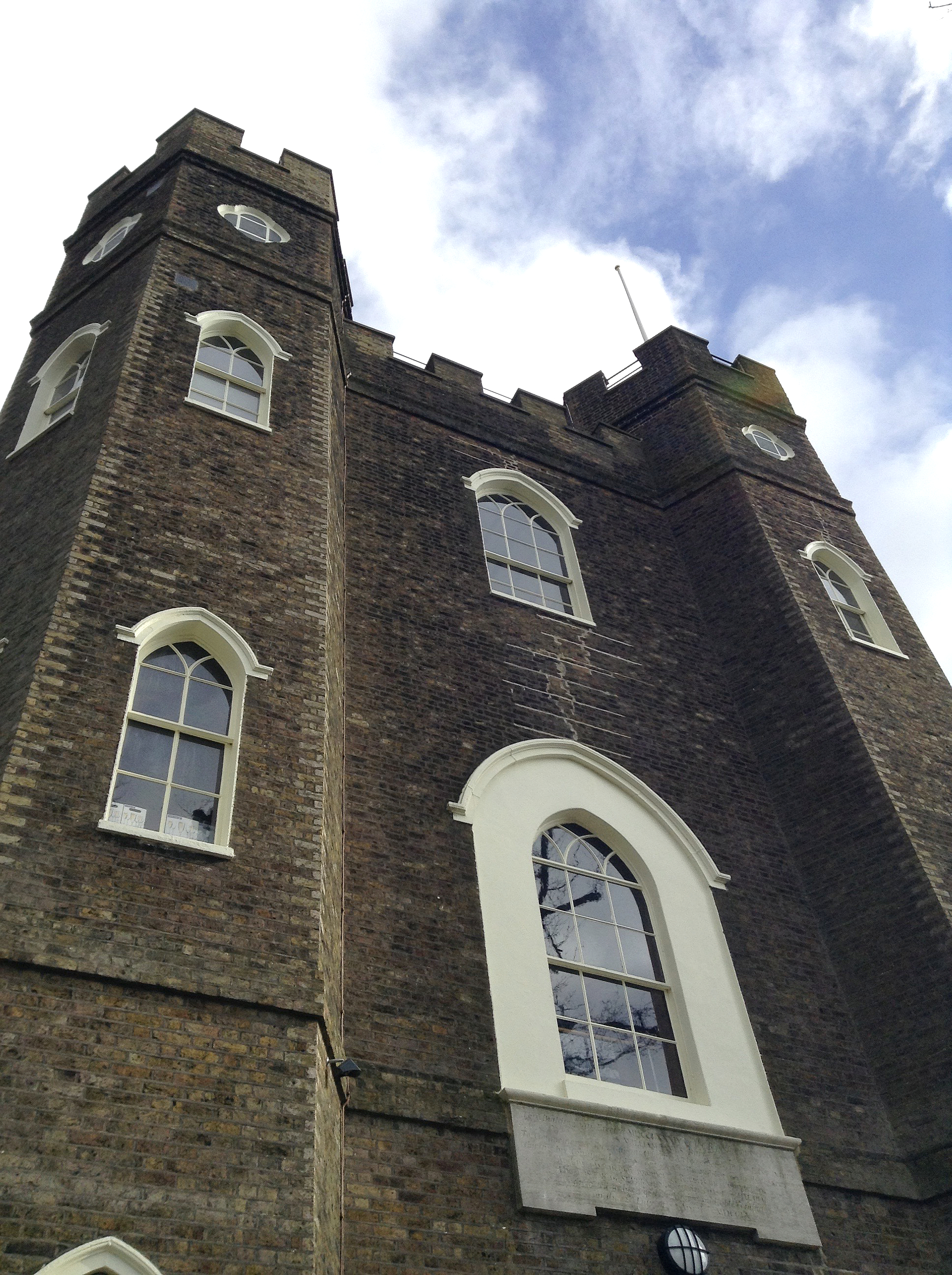 a view of severndroog castle in shooters hill against blue sky and clouds