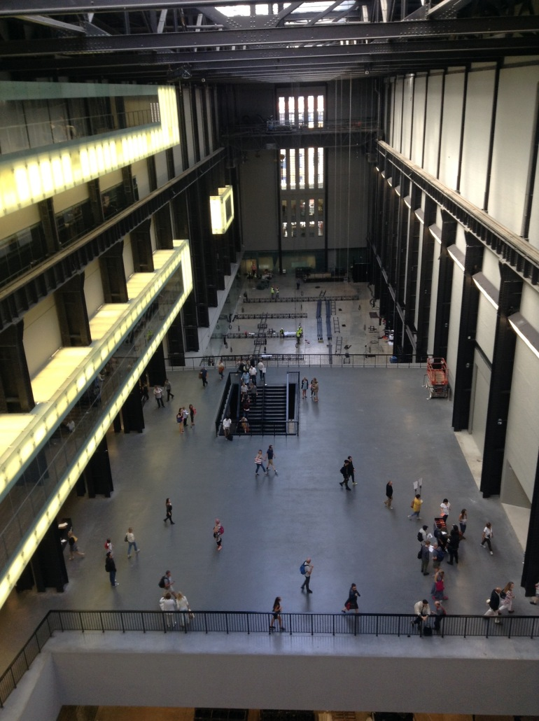 huge space inside art gallery with people wandering