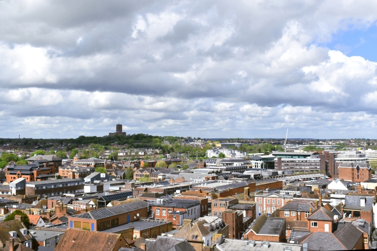view over urban landscape with hill in distance and cathedral